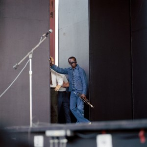 UNITED STATES - JULY 04:  NEWPORT JAZZ FESTIVAL  Photo of Miles DAVIS, posed, at side of stage  (Photo by David Redfern/Redferns)