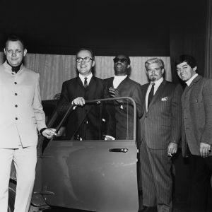 "Stevie Wonder presents a ""Motown Mini"" to a British competition winner in London, 1969, alongside the company's Phil Jones and Barney Ales and, at right, DJ Tony Blackburn. Courtesy of Barney Ales"
