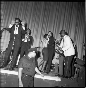 The Miracles light up the night during a show in the early 1960s. Motown Records Archives. Courtesy of the EMI Archive Trust and Universal Music Group.